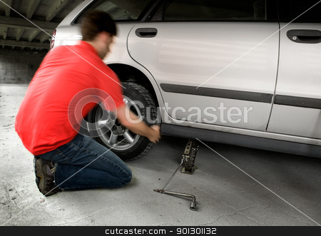 Quick Tire change stock photo, A male changing a tire quickly by Tyler Olson