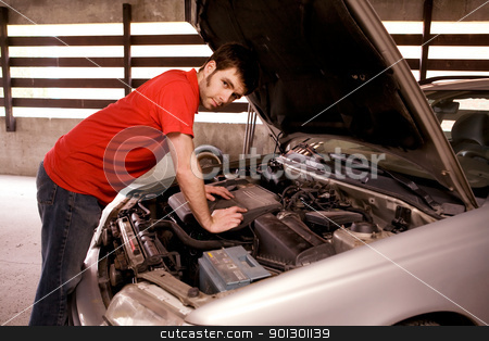 Car Repair stock photo, A male looking under the hood of a car by Tyler Olson