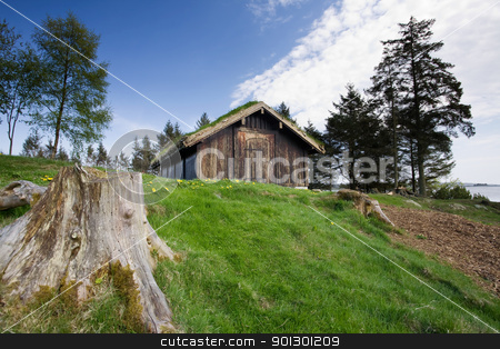 Nature Cabin stock photo, An old building on the norwegian coast by Tyler Olson