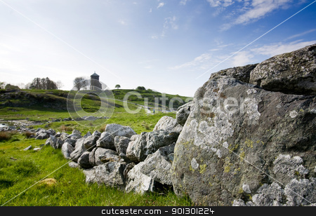 Stone Fence stock photo, A very old stone wall in rural Norway by Tyler Olson