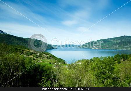 Rural Norway stock photo, A coastal landscape with meadow and ocean by Tyler Olson