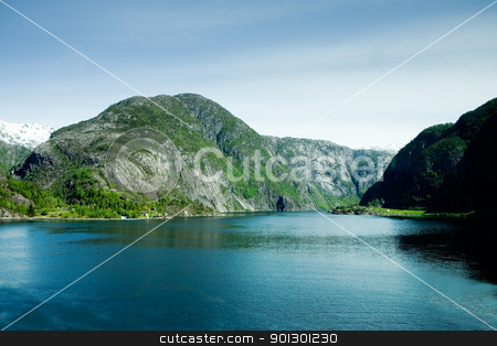 Mountain fjord stock photo, A fjord and rural norway with a blue sky by Tyler Olson