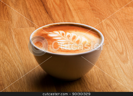 Latte Coffee stock photo, A latte in a bowl with latte art by Tyler Olson