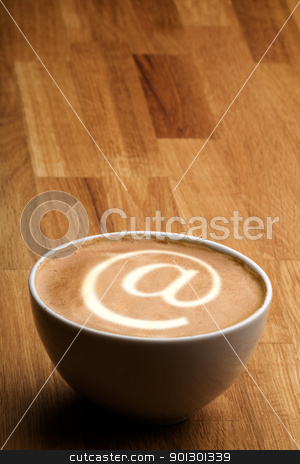 Internet Cafe stock photo, A cappuccino with an @ sybol in the milk by Tyler Olson