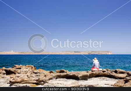 Malta Fisherman stock photo, A maltese fisherman fishing in the sea by Tyler Olson