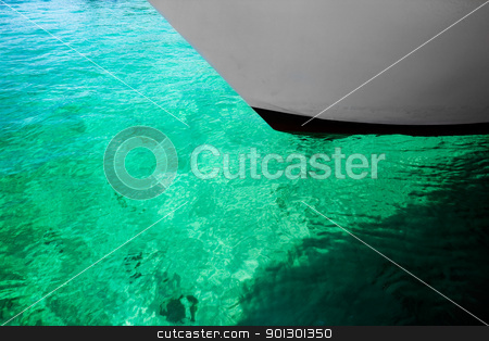 Green Water Background stock photo, An abstract bakground of green water and a boat by Tyler Olson