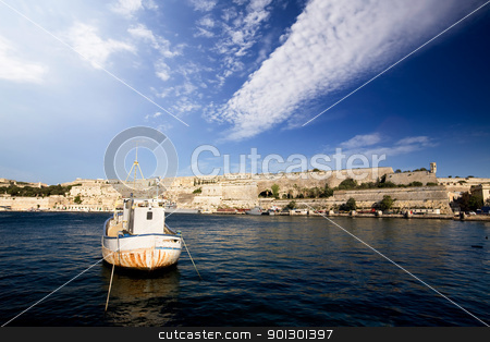 Old  Boat Harbor stock photo, An old harbour with a fishing boat.  Valletta, Malta by Tyler Olson