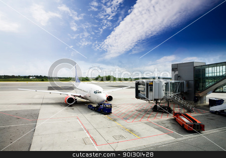 Airport Terminal stock photo, An airplane at the airport on the tarmac by Tyler Olson