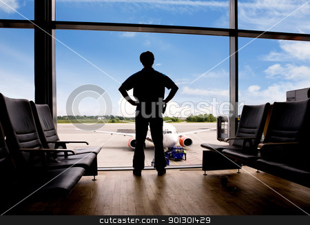 Waiting at Airport stock photo, A male waits in a terminal at an airport by Tyler Olson