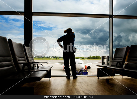 Airport Wait Transfer stock photo, A male waiting sleeping in the airport by Tyler Olson