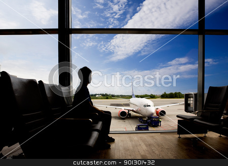 Airport Terminal stock photo, Waiting at airport for flight by Tyler Olson