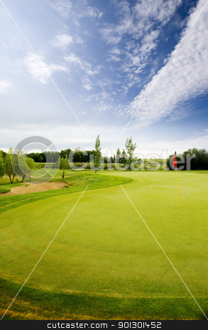 Golf Course  stock photo, A golf course on a beautiful blue day by Tyler Olson