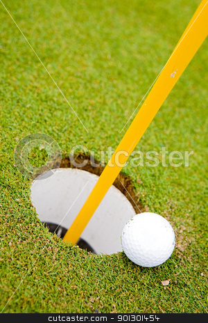 Golf Ball Hole stock photo, Golf ball very close to going in the hole by Tyler Olson