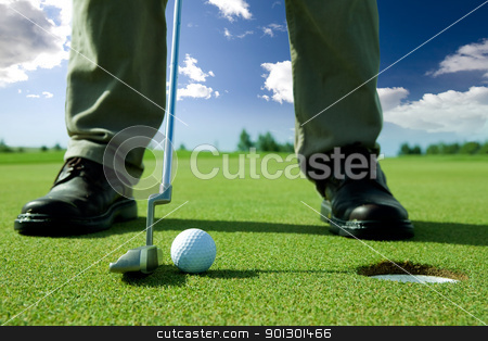 Golf Putt stock photo, A golf put into the hole by Tyler Olson