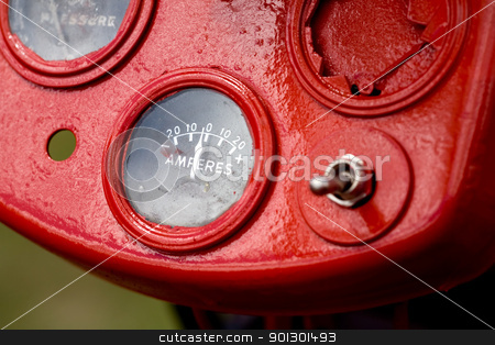 Old Amperes stock photo, Retro tractor dials - focus on the amperes gauge by Tyler Olson