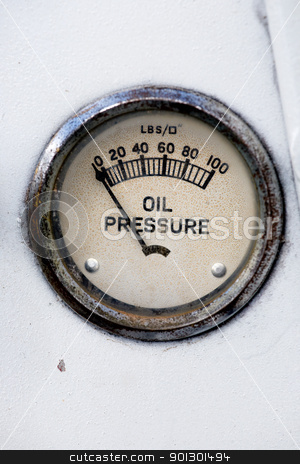 Oil Pressure Gauge stock photo, An old retro steampunk style oil pressure gauge by Tyler Olson