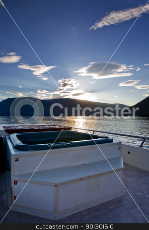Luxury Boat hot tub stock photo, A hot tub on a luxury boat on a lake at sundown by Tyler Olson