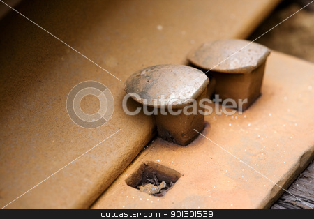 Railroad Spike  stock photo, close up of a railroad spike by Tyler Olson