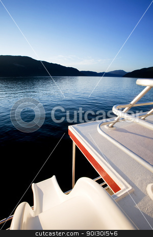 Luxury Yacht stock photo, A slide off a luxury yacht into a beautiful lake at sunset by Tyler Olson