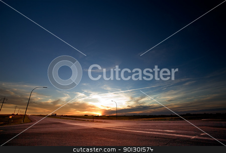 Highway Sunset stock photo, A sun setting on a large highway on the prairie by Tyler Olson