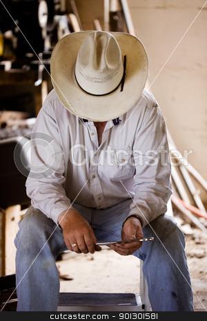 Tired Farmer stock photo, A farmer taking a break by Tyler Olson