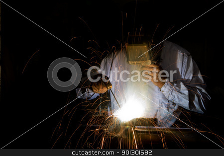 Welding stock photo, A male welding metal by Tyler Olson