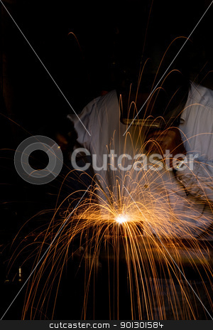 Welder stock photo, A male welding metal by Tyler Olson