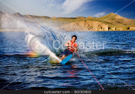 Waterskiing stock photo, A male waterskiing on a beautiful lake by Tyler Olson