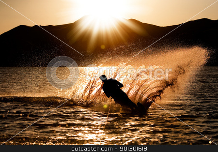 Sunset Waterski stock photo, A male waterskiing in the evening sunset by Tyler Olson