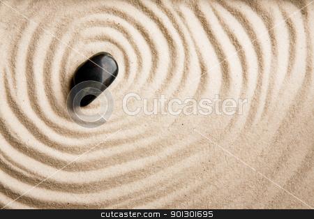 Sand Swirl Background stock photo, A circular sand swirl background texture abstract by Tyler Olson
