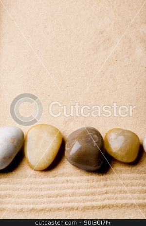Rock on Sand Beach stock photo, A sand beach abstract background with rocks by Tyler Olson