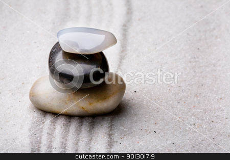 Zen Rock Stack stock photo, tower of rocks in a sand zen rock garden by Tyler Olson