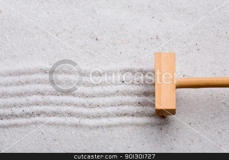Rake Sand stock photo, A small rake, creating a design in a zen garden by Tyler Olson