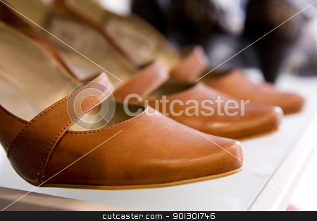 Shoe Store stock photo, Brown Leather shoes in a shoe store by Tyler Olson