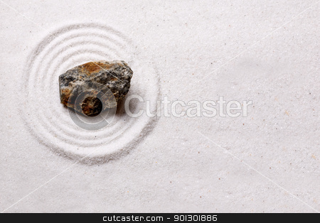 Zen Rock Garden Background stock photo, A simple zen rock garden design with a rough stone by Tyler Olson