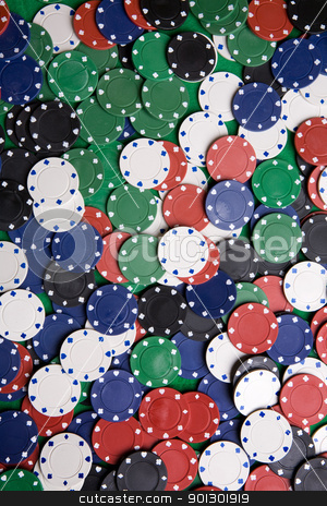 Casino Chip Background stock photo, A background with casino chips of many colors by Tyler Olson
