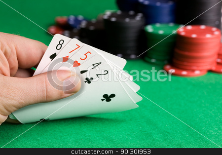 Poker Bluff stock photo, Bluffing with a poor poker hand by Tyler Olson