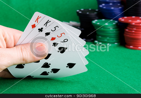 Two Pair stock photo, A poker hand with two pair and chips in the background by Tyler Olson