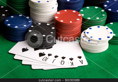 Royal Flush stock photo, A royal flush in spades with poker chips in the background by Tyler Olson