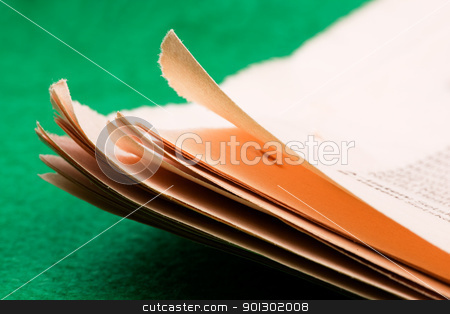 Newspaper Detail stock photo, A background detail of a newspaper over green by Tyler Olson
