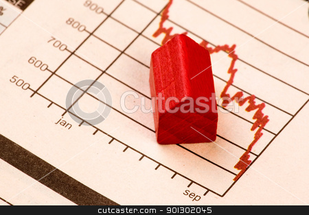 Housing Market stock photo, Housing market concept image with graph and toy house by Tyler Olson