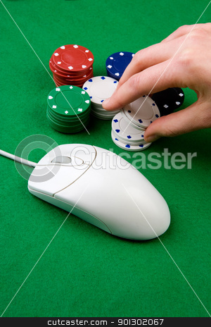 Online Gambling stock photo, An online gambling concept - computer mouse, hand and casino chips by Tyler Olson