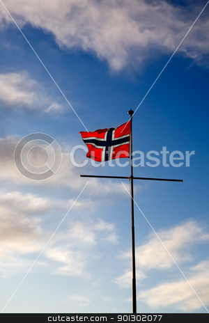 Norwegian Flag stock photo, A norwegian flag blowing in the wind against a blue sky by Tyler Olson
