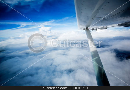 Small Aircraft Wing stock photo, A wing on a small aircraft in flight by Tyler Olson