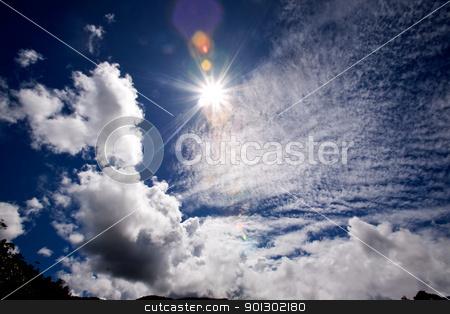 Sunburst stock photo, The sun in a blue sky by Tyler Olson