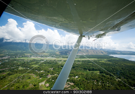 Tropical Flight stock photo, An aerieal photo taken from a small airplane - Indonesia by Tyler Olson