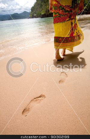 Walk on Beach stock photo, A female walking on the beach by Tyler Olson
