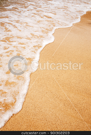 Wave Sand Background stock photo, A wave breaking on the sand - Background texture by Tyler Olson