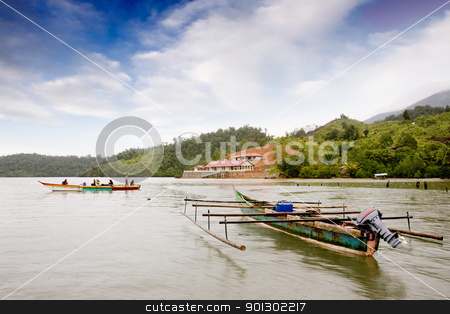 Indonesian Traditional Boat stock photo, A pair of traditional boats in Indonesia by Tyler Olson
