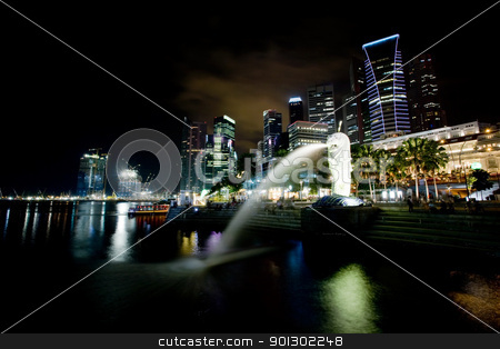 Singapore stock photo, A view of singapore at night with the merlion in the foreground by Tyler Olson